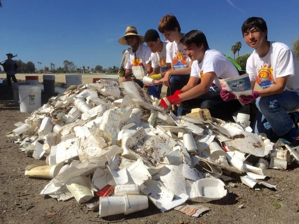 Culver City High School BCR Club members gather around a pile of polystyrene debris collected at a Ballona Creek cleanup earlier this year.